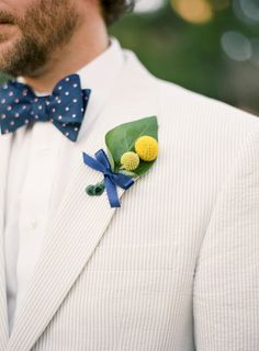 Yellow billy button boutonniere, navy blue bowtie, seersucker suit, preppy groom style // Tanja Lippert Photography