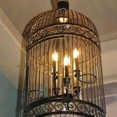 Birdcage Chandelier DIY would look epic as a light fixture in the steam punk home!