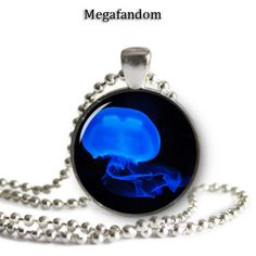 """Blue Jellyfish Photo Glass Necklace 1"""" round Pendant with a beautiful high resolution printed image sealed under a high quality glass dome. Silver plated pendant tray. Come with a silver plated ball c"""