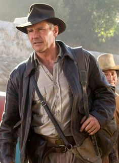 """In in the """"Indiana Jones and the Last Crusade"""" film, Harrison Ford wore a brown leather jacket. Indiana Jones Jacket is a custom work of Indiana Jones film series, designed by Deborou Nidolin Landes and Peter Bollowa."""