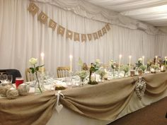 Wedding meal top table rustic marquee ivory natural hessian bunting gypsophila roses