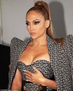 Jennifer Lopez, 51, flaunts her cleavage in a low-cut dress from the Balmain show | Daily Mail Online