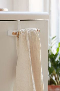 An over-the-cabinet towel hanger that maximizes your surfaces.