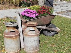 I think I need an old milk can to go with my rustic wheelbarrow <3