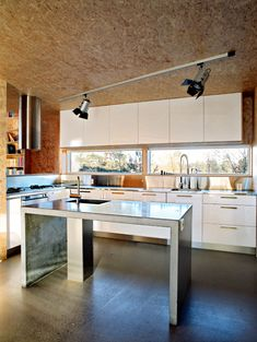 Interior Decorating with OSB (oriented strand board) Oriented Strand Board, Chipboard Interior, Triangle House, Norwegian Wood, Tiny House Movement, House In The Woods, Kitchen Interior, Interior Architecture, Kitchen Dining