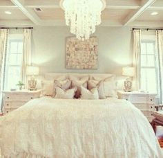 What could be better than a cozy white on white bedroom with an elegant chandelier? #lighting