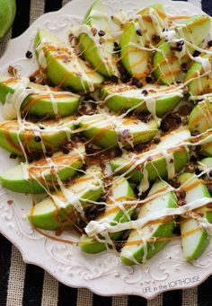 Caramel Apple Nachos Recipe: Try this creative take on nachos by subbing chips for healthy apples and a little caramel flare.