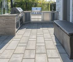 This outdoor kitchen is made with the Aspen slabs in the Sky Grey. The linear installation of the paver is modern and very trendy! Modern Backyard, Backyard Ideas, Outdoor Kitchen Grill, Champagne Color, Aspen, Fireplaces, Concrete, Brick, Landscaping