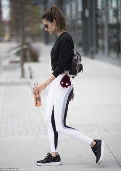 Alessandra Ambrosio shows off her fine form in white leggings 504cbfbae26a0