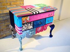 A lovely colorful little chest of drawers.
