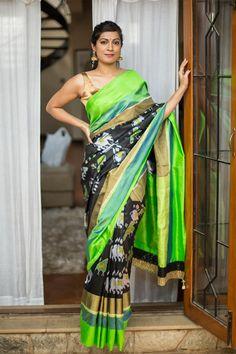 Black pochampally pure silk saree with elephant parrot ikat motifs and green zari border #pochampally #ikat #silk #handloom #india #houseofblouse