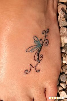 this is a really pretty foot tattoo. I think it would look better on the back of the ankle:)