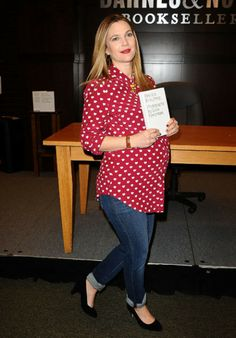Drew Barrymore looks all sorts of adorable in her red and white polka dot blouse and casual jeans.