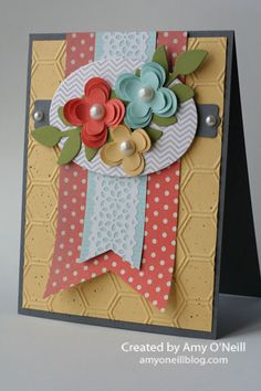 Stamps:  Oh, Hello Ink:  Basic Gray Paper:  Basic Gray, So Saffron, Calypso Coral, Pool Party, Old Olive, Whisper White, Tea for Two dsp, In Color dsp stack Embellishments:  Floral Fusion Sizzlits, Honeycomb embossing folder, Ovals Collection framelits, Secret Garden framelits (leaves), Modern Label punch, Pearl Basic Jewels, Large Pearl Basic Jewels, Delicate Details Lace Tape, Color Spritzer Tool