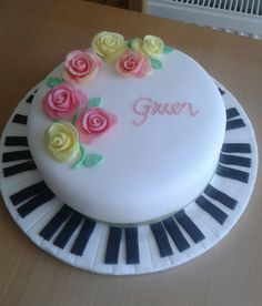 Pretty roses and piano cake by Kim Hall