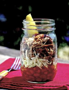 "BBQ in a jar - what a novel idea! ""Divide 2 cups warm baked beans evenly among 4 Mason jars or large heat-proof cups; top each with 1/2 cup coleslaw, 1/4 pound warm shredded barbecued pork, and 1 to 2 tablespoons sauce. Serve with dill pickle wedge"""