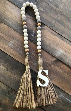 Awesome easy home decor are offered on our internet site. look at this and you wont be sorry you did. Wood Bead Garland, Beaded Garland, Cute Dorm Rooms, Cool Rooms, Farmhouse Side Table, Coastal Farmhouse, Farmhouse Decor, Easy Home Decor, Wooden Beads