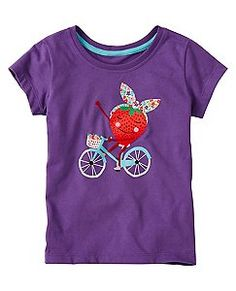It's a bit weird, but BIKE and HAIR TIE ...gotta love that a bit...Girls Art Tee In Supersoft Jersey by Hanna Andersson