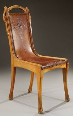 Eugene Gaiiilard , rare Art Nouveau carved walnut chair with a leather seat, hand tooled with an iris flower, ca.1900