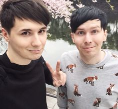 Dan and Phil in Japan with the cherry blossoms !!