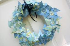 Darling paper wreath.  Only takes 3 sheets of paper, and is easy, too!