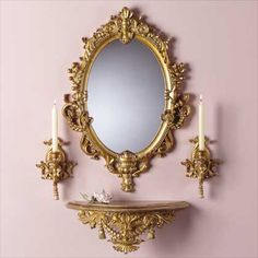 Baroque-style wall furnishings, ornately carved and painted gold. Mirror, shelf, and two candleholders (tapers only) complete the set. Mellow gold ornate detailing add a palatial touch to any wall.