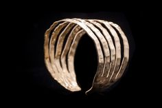 This is a cuff bracelet Pure Handmade hammered 18ct Goldplated Bronze - Designed and made in Greece By George Lemmas & Mykonos Alternative Price at 25euro