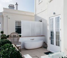 The ground floor balconies at @lympstone_manor are one of our favourite spots in the hotel. Would love to be in that carved marble tub with a glass of bubbly right about now. 🥂   #architecture #designer  #hospitality #outdoors #backyard #Interiordesign #inspo #designinspo #Interiorstyling #archdaily #archilovers #interiordecor #moderndesign #interiors #interiorstyle #interiorinspo #architecturaldigest #interior_design #interiorarchitecture