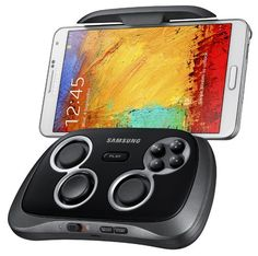 Samsung had just released a wireless gaming controller called GamePad which can easily turn your smartphone or tablet into full blown gaming console. The GamePad has a telescoping cradle . Iphone Mobile Phone, Samsung Mobile, Galaxy Note 3, Gadgets And Gizmos, Electronics Gadgets, Smartphone, Samsung Note 3, Samsung Galaxy, Mobiles