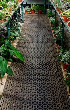 Stunning greenhouse floor: metal grating. Could this be used above a thermal sand sink?