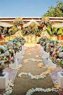 Pastel blooms create a bright and beautiful ceremony space.