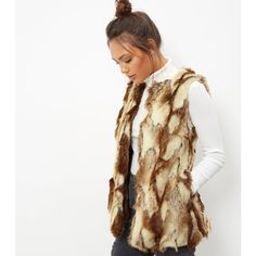 New Look Blue Vanilla Light Brown Jacquard Faux Fur Gilet ($74) ❤ liked on Polyvore featuring outerwear, vests, light brown, white vest, fake fur vests, faux fur waistcoat, faux fur vests and white faux fur vest