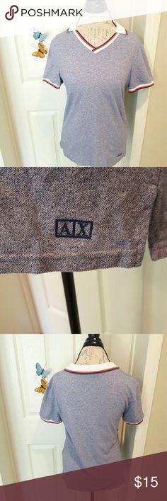 Armani Exchange - v-neck polo In perfect condition! Very nice blue Polo to wear anytime. Has a white collar trimmed in dark blue and orange. Has the AX symbol on the bottom of the shirt. From a smoke and pet free home. Fast shipping! Armani Exchange Tops