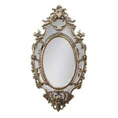 """With simple, iconic opulence, our cartouche-style La Rochette Mirror is an ideal centerpiece for today's eclectically dressed interiors. The oval-shaped mirror features a richly carved mahogany wood frame with a silver finish. La Rochette Mirror (105731): 33""""W x 2""""D x 61""""H."""