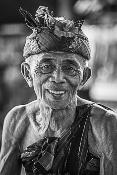 A Old Man in Bali by David Wang, male, oldie, aged, wrinckles, portrait, culture, fashion, beard, smile, smiling, face, photograph, photo b/w.