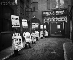 WARDOUR STREET, London. A line of men standing outside Mitchell Motors Company (114 Wardour Street), wearing sandwich boards advertising United International Motors Ltd. 1910