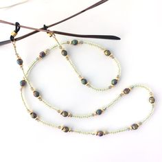 Czech Metallic Faceted Glass Bead Eyeglass Chain by Plumbeadacious - this simple design is classic and can be worn everyday. Faceted Glass, Glass Beads, Beaded Lanyards, Simple Designs, Eyeglasses, Jewerly, Beaded Necklace, Rosaries, Chain