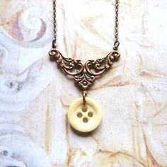 Halcyon Days - Vintage Bone Button and Ornate Antiqued Copper Handmade Necklace with Gift Box by ComeDayGoDay on Etsy https://www.etsy.com/listing/208252906/halcyon-days-vintage-bone-button-and