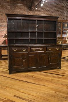 english sycamore dresser with raised open shelved back above three frieze…