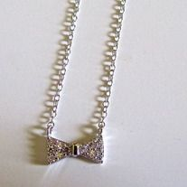 "Charming Sterling Silver Bow Necklace. Very delicate and beautiful.    16"" Chain    This is a pre-order item. Reserve yours today!"