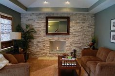 Fireplace: Square Framed Mirror Light Brown Stone Fireplace Brown Sofa Set Brown Rug Hidden Lamp Black And White Sitting Lamp Stone For Fireplace, Decorate, Glass Stone Wall, Inspired Homes, Stone Accent Walls, Fireplace Surrounds, Modern House, Fireplace Design, House Interior, Indoor Fireplace, Modern Fireplace