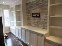 large wall units with ladder backdropped with blue/grey wall - Google Search