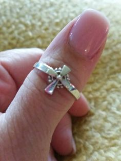 Check out this item in my Etsy shop https://www.etsy.com/listing/499832978/925-silver-cross-ring-size-875