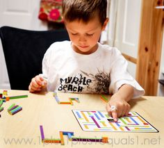 Learning Resources iTrax | This is a FUN game, and I love it because the rules are simple and the pieces can be used in different creative ways outside of the game. I love alternate uses!  Review by 1plus1plus1equals1.net