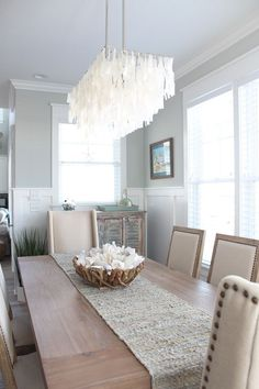 Check out our Home of the Month feature: A Serene Ocean Isle Beach Home #OIBHAPPY - Dream House - Coastal Decor - Simple Stylings - http://www.simplestylings.com - North Carolina - Beach House - dining room - capiz chandelier - shell decor