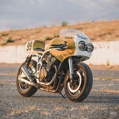 A new bike from the crew at is a bit like a Mike Tyson uppercut: it arrives without warning, and it's a knockout. Here's the latest, a Suzuki Bandit 1200 with a chequered past. Read the. Custom Motorcycles, Custom Bikes, Cars And Motorcycles, Honda Motorcycles, Vintage Motorcycles, Suzuki Cafe Racer, Suzuki Motorcycle, Cafe Racers, Suzuki Bikes