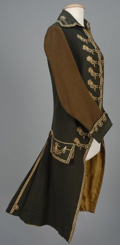 Gentleman's Embroidered Wool Frock Coat, 2nd half 18th Century. Black with fold over collar and cuff having brown sleeve decorated with polychrome floral embroidery, oversized pockets beneath squared pocket flaps, pleated back and embroidered buttons, silk lining.