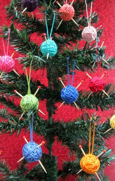 Yarn ball ornaments.  They are simple to make if you want to do your own.  I used a small polystyrene ball as a base and glued the yarn on to start with.  Then you just wind round carefully until the base is hidden and the ball is the size you want.  Glue the tail back on itself to form the hanger.  The needles are made from cocktail sticks with beads on the end and pushed through the ball…simples!