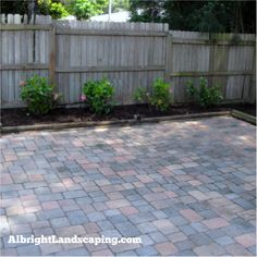 Paver patio with plant beds for the ultimate low maintenance yard!