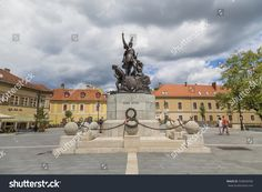 EGER, HUNGARY - AUGUST Monument Istvan Dobo - a beautiful bronze statue depicting the famous Hungarian warlord and commander of the XVI century Istvan Dobo Underwater Sculpture, Hungary, Photo Editing, Royalty Free Stock Photos, Bronze, Statue, Mansions, House Styles, Pictures